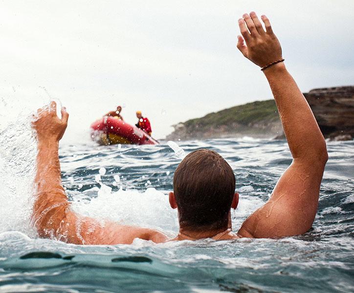 IRB rescuing swimmer