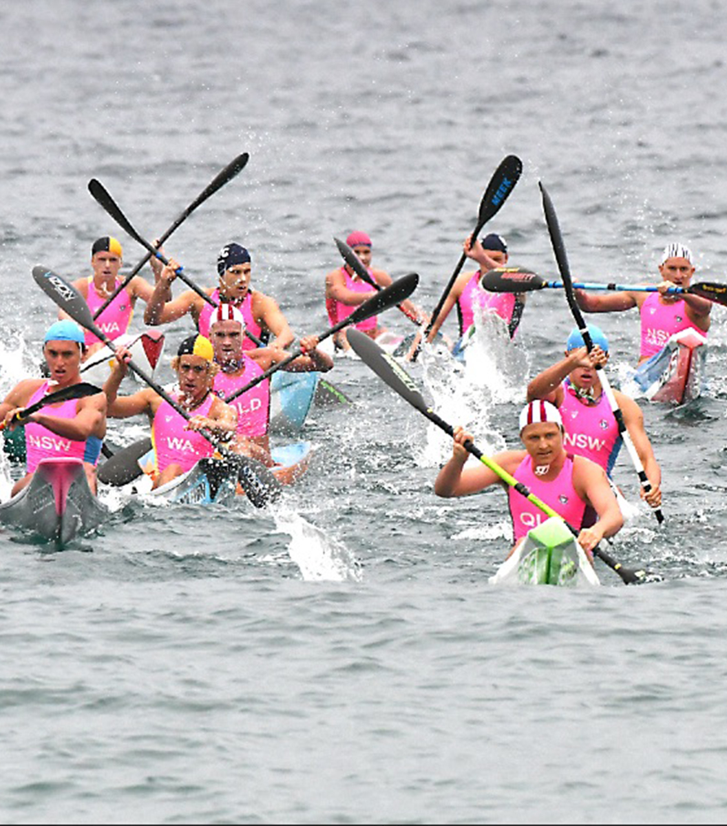 Group of competitors in ocean on skis